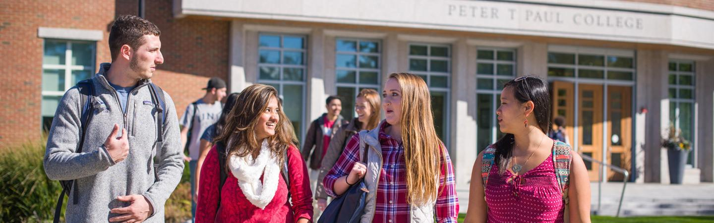 Students walking in front of the Peter T. Paul Building
