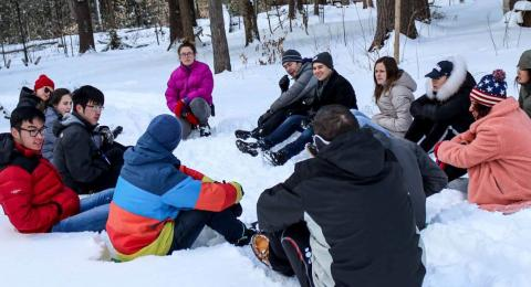 Leadership Camp group sitting in a circle in the snow