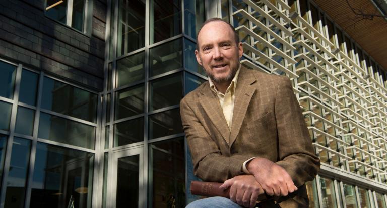 Professor of economics Bruce Elmslie studies international economics