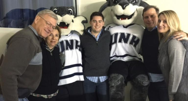 Armand Francouer '65 COLA, Kay Ruma '65 COLA, Colin Kelley '12, Kevin Knarr '91 and Emily Knarr at a UNH hockey game