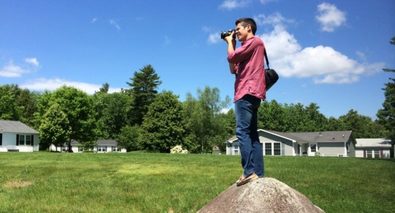 Kris Roller '15 takes photos of a manufactured home community as part of his social innovation internship with ROC USA during the summer of 2014.