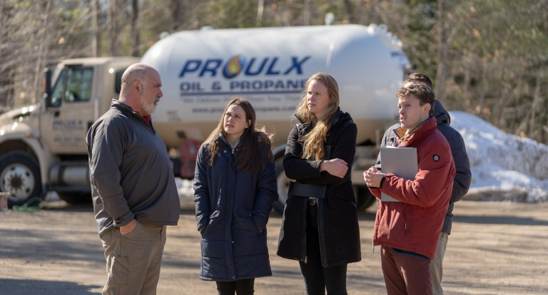 Paul College students working on capstone project with Proulx Oil