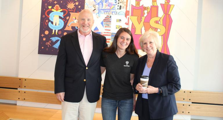 Crowe poses with Paul College hospitality management chair Nelson Barber and Dean Deborah Merrill-Sands at the Saxbys Durham grand opening