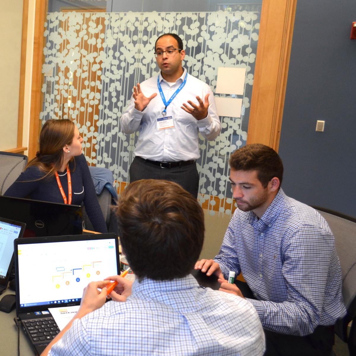 Liberty Mutual employee coaches group of Paul College students in breakout room